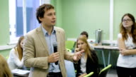 Lecture by the trainer at the University of Management. Mentor conducts a seminar on management for young students video
