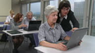 HD: Lecturer Helping Seniors Using Computer video