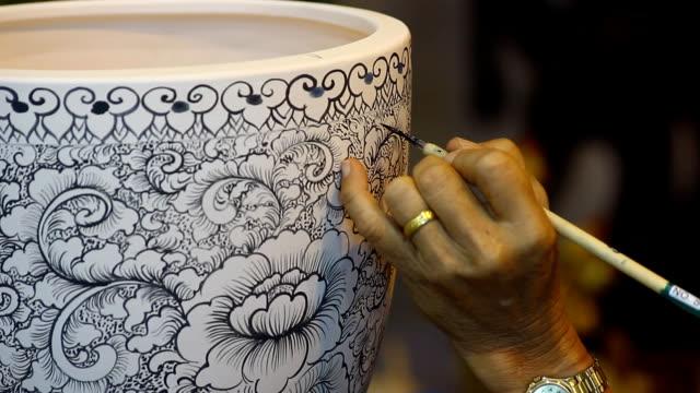 left hand color paint on white ceramic bowl video