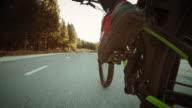 POV Leg of biker riding on asphalt road in countryside video
