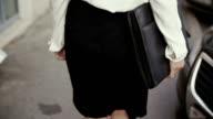legs businesswoman walking in old city. slow mo video