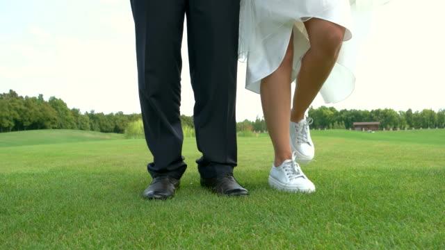 Legs dancing on grass. video