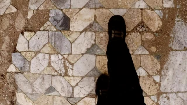 POV legs go on ancient marble tiles  ruins antique roman town Salamis east Cyprus Famagusta video