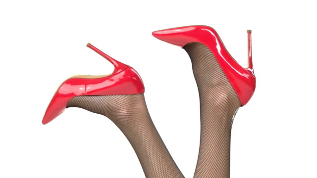 Legs in glossy red heels. video
