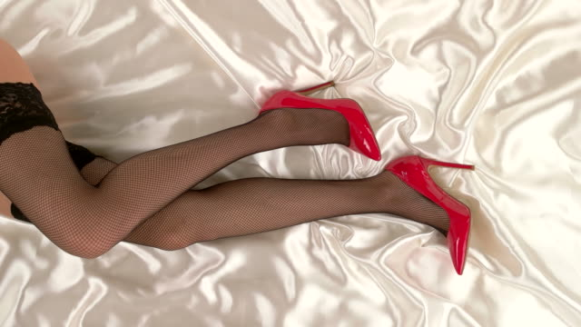Legs in stockings and shoes. video