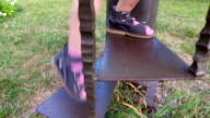 Legs. Little girl climbing on metal ladder. The staircase is located in the park. video