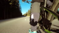 POV Legs of biker pedaling in sunshine video