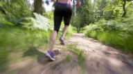 TS Legs of female running through forest video