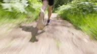 TS Legs of a male runner running through the forest video