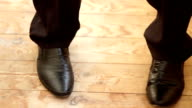 legs of a young man in the dancing shoes video