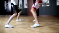 Legs of fighters in the spar are jumping on the floor in the training hall video