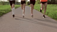 SLO MO TS Legs of runners running on a road video