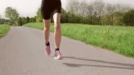 SLO MO TS Legs of running woman moving on asphalt video
