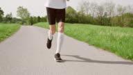 SLO MO TS Legs of senior marathon runner in motion video