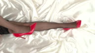 Legs of woman in bed. video