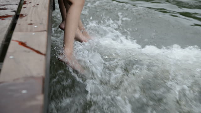 Legs of young teen Enjoying the river rafting video