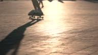Legs on skateboard in motion. video