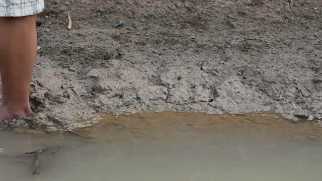 Legs sinking mud. video