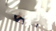 Legs wearing dark blue heels. video