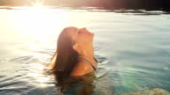 Leisure Luxury Pool Spa. Sensual Woman Relaxing at Sunset. video