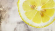 Lemon, ice and water background video