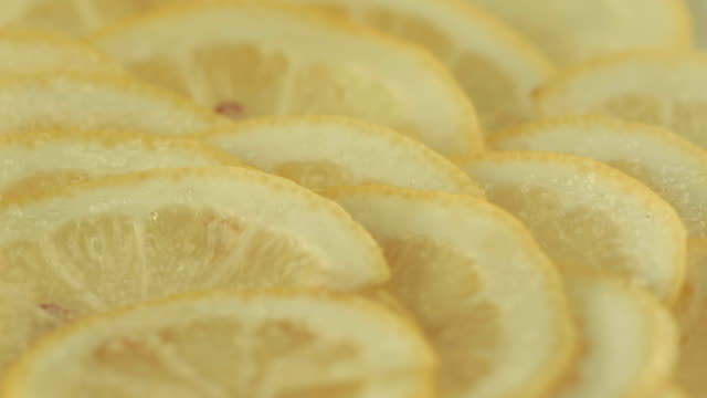 Lemon slices sprinkled with sugar video