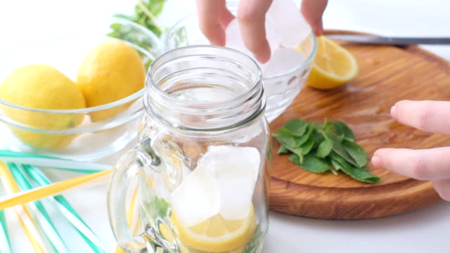 Lemonade preparation. Concept of cooking. video