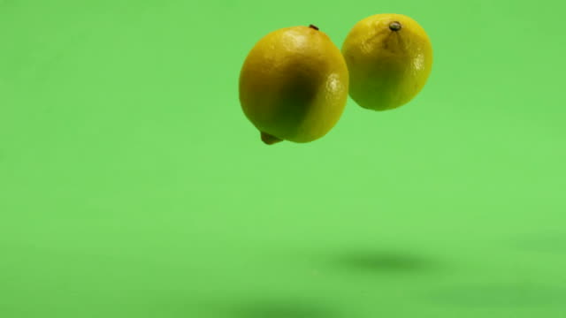 Lemons falling. Green screen. Slow Motion. video
