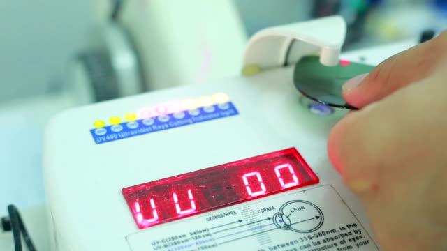 Len UV tester in optical store by optometrist video