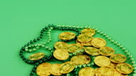 Leprechauns gold and green necklace on green background for st patricks video