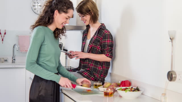 Lesbian couple cooking at home video