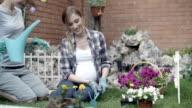 HD: Lesbian Couple Gardening In A Backyard. video