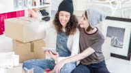 Lesbian couple looking for decoration ideas at the new home video