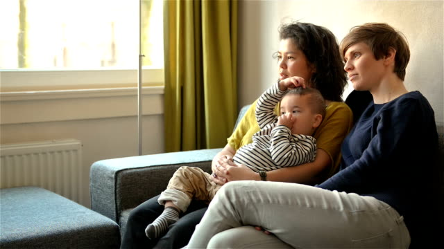 DOLLY: Lesbian couple watching TV with their son video