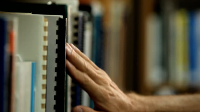 Library - Taking book off the shelf video