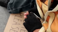 Life of poor and homeless, male counting money on the street, destitution video