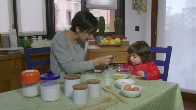 Lifestyle Baby And Woman Cooking Together In Home Kitchen video