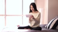 Lifestyle For Asian Woman With Ipad In Bedroom At Home video