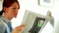 Lifestyle newspaper girl    CM  LI  RE video