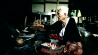 Lifestyle Senior asian woman Sitting a Cooking Food, Slow motion video