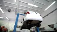 Lifting cars in car repair shop video