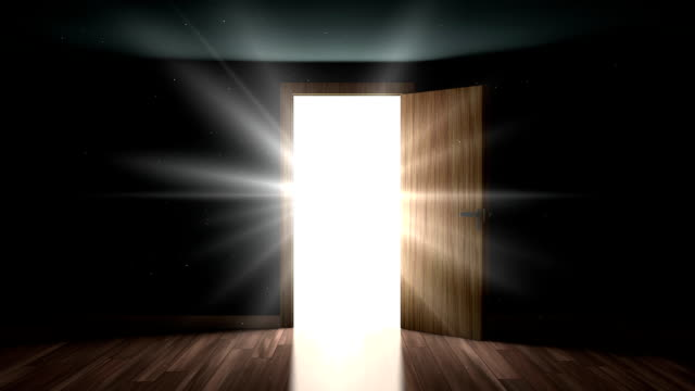 Light and particles in a room through the opening door video