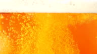 Light beer is poured in a glass. Closeup. Slow motion video