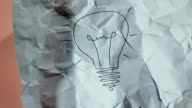 light bulb drawing paper ball unwrapping video