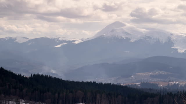 Light Clouds and Fast Shadows Moving Across the Valley and the Slope of the Mountain Hoverla in the Carpathians video