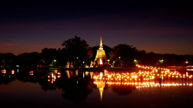 light in Buddha Statue at Temple in Loy Kratong Festival, Sukhothai Historical park , Thailand video