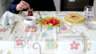 Light mediterranean breakfast served with fresh Turkish tea on table video