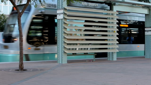 Light Rail Train Cruises by Stop Downtown video