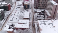 Light rail train traveling through a city after a snow storm video