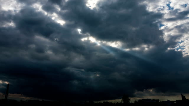 Light rays shine through the clouds video
